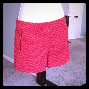 Red Cynthia Rowley shorts with white polkadots.